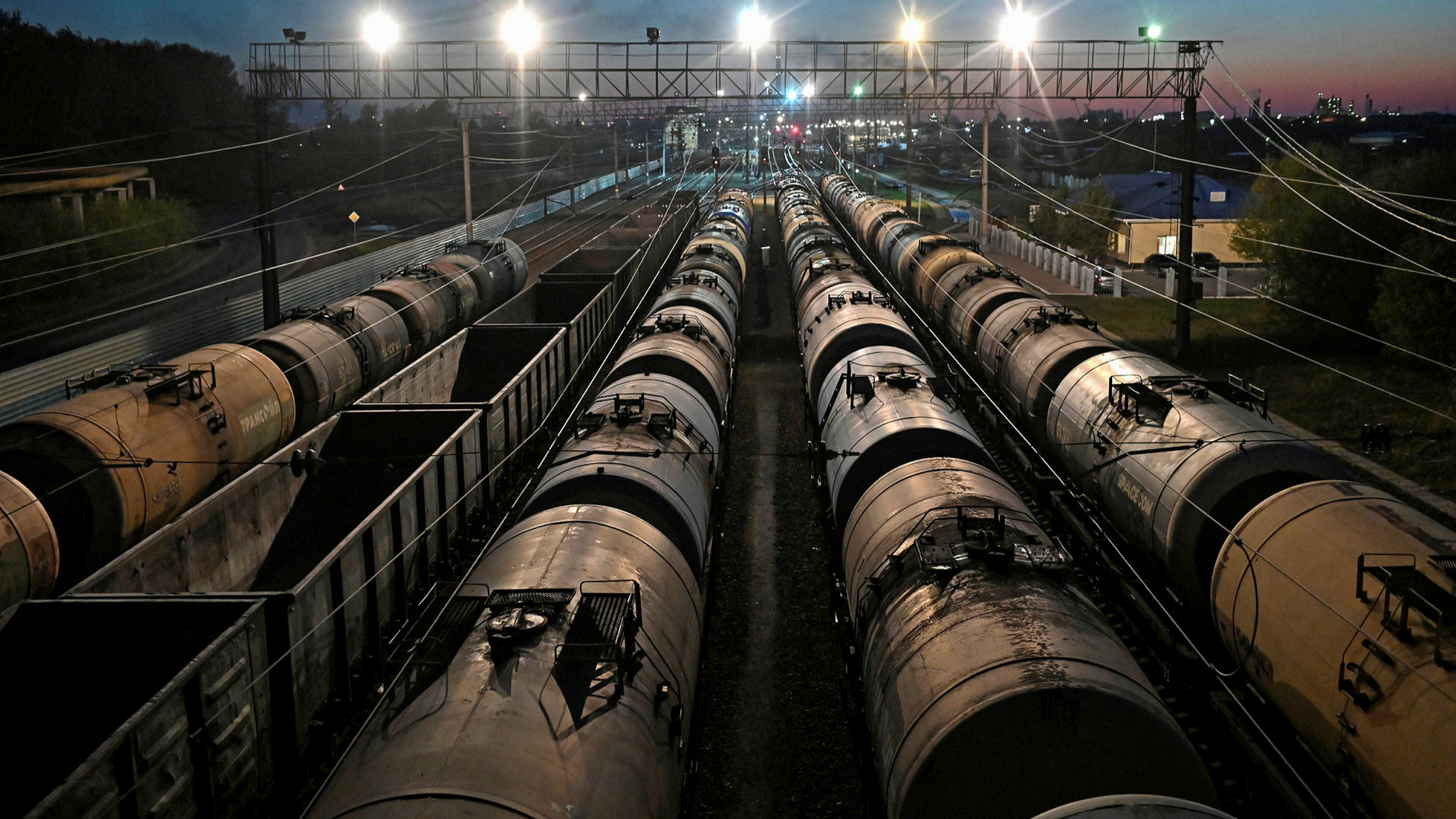 Railroad freight cars, including oil tanks, in Omsk. Russia and other oil exporters face trade balance losses this year of more than 3% of GDP, the IMF warns