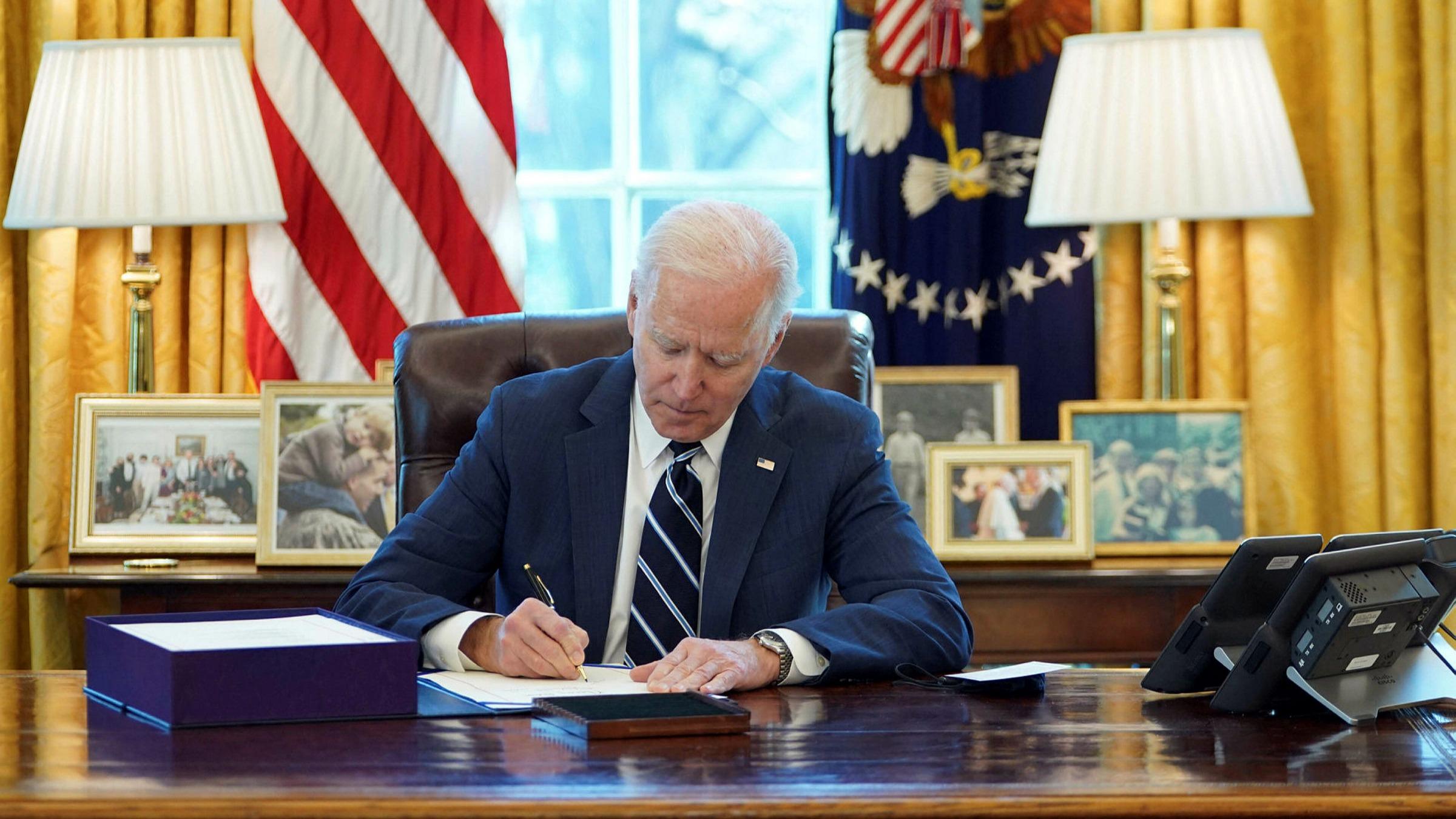 Joe Biden signs $1.9tn stimulus bill into law